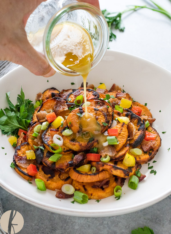 Grilled Sweet Potato Salad with Maple Bacon Vinaigrette is smoky grilled sweet potato with crumbled bacon and fresh veggies tossed in a maple bacon dressing!