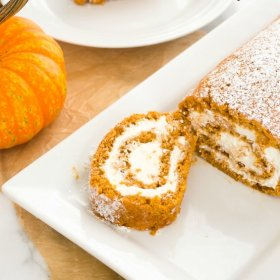 front view of pumpkin cake roll slice on a platter