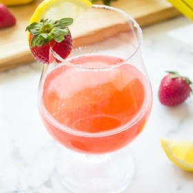 strawberry lemon drop in glass with sugar on the rim