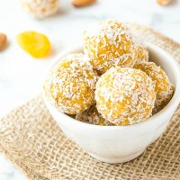 Close up of apricot energy balls in white bowl