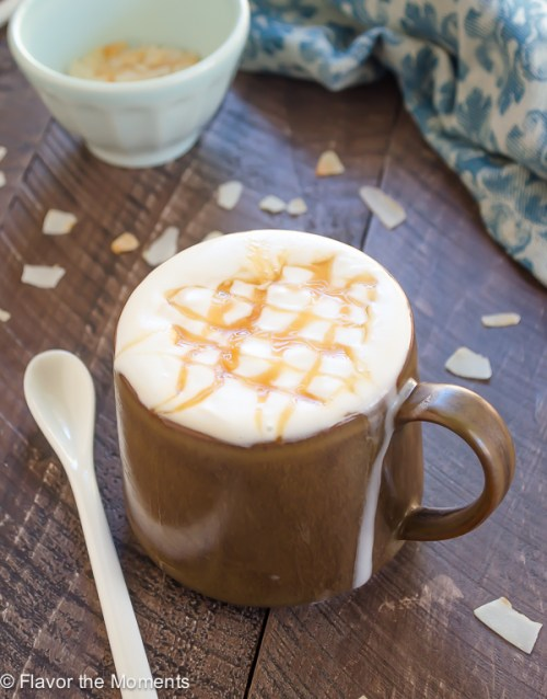 Coconut Caramel Macchiato is an easy, homemade coffee drink with espresso, creamy coconut milk, and silky caramel syrup. It's a great way to elevate your normal coffee routine! @FlavortheMoment