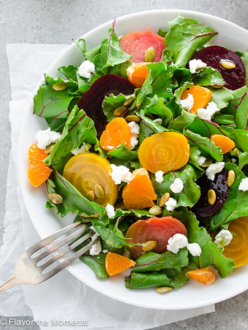 Roasted Beet Salad with Goat Cheese and Orange is sweet roasted beets with beet greens, goat cheese, and orange tossed in a white balsamic vinaigrette. It's sweet, savory, and perfect for beet lovers! @FlavortheMoment