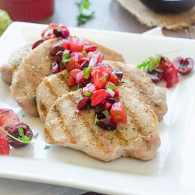 Grilled Pork Chops with Spicy Cherry Plum Salsa are juicy grilled pork chops with grilled plum, cherry, and jalapeno salsa. It's an easy, delicious summer meal! @FlavortheMoment
