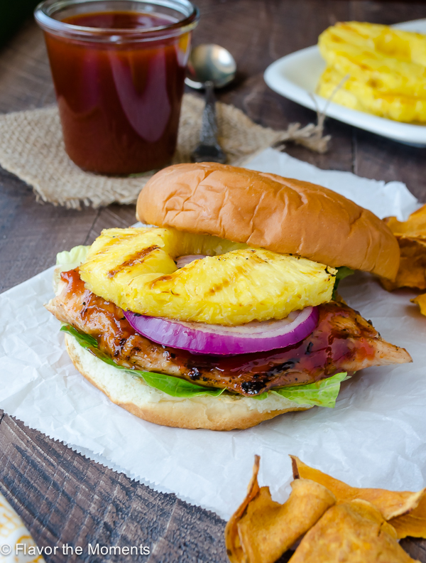 Honey Pineapple Barbecue Chicken Sandwich is grilled chicken smothered in a homemade sweet 'n smoky honey pineapple barbecue sauce with juicy, grilled pineapple and red onion. This is a 30 minute meal that's perfect for summer! @FlavortheMoment