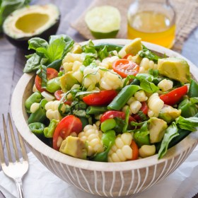 close up front view of summer succotash salad in bowl