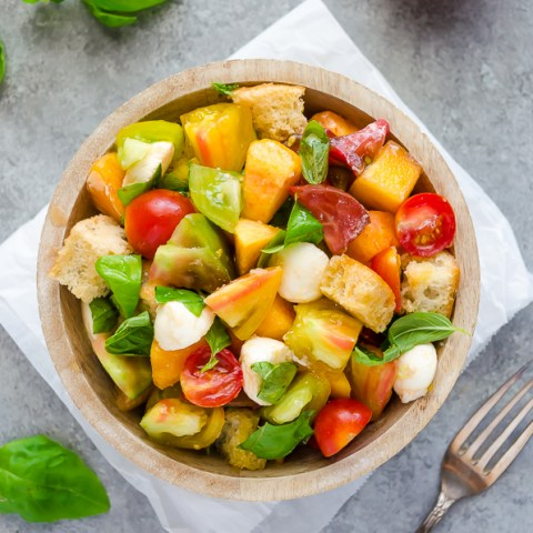 peach and tomato caprese salad overhead shot in bowl