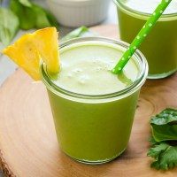 Power Green Smoothie in jar with pineapple and straw
