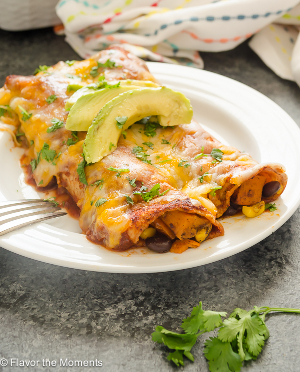 Sweet Potato, Black Bean, and Corn Enchiladas are hearty vegetarian enchiladas with a homemade 10 minute enchilada sauce and plenty of cheese. This is a great make-ahead meal for those busy weeknights! @FlavortheMoment
