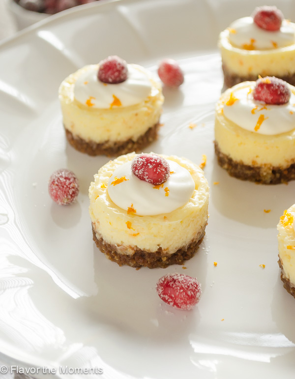 Mini Cranberry Orange Cheesecakes are creamy bite-sized cheesecakes bursting with holiday flavor! @FlavortheMoment