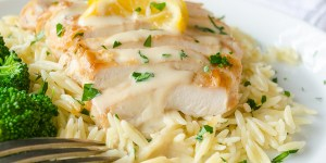 30-Minute Chicken with Greek Avgolemono Sauce is pan fried chicken smothered in a silky smooth, lemony Greek avgolemono sauce. Serve with rice or orzo for a quick, delicious weeknight meal! @FlavortheMoment