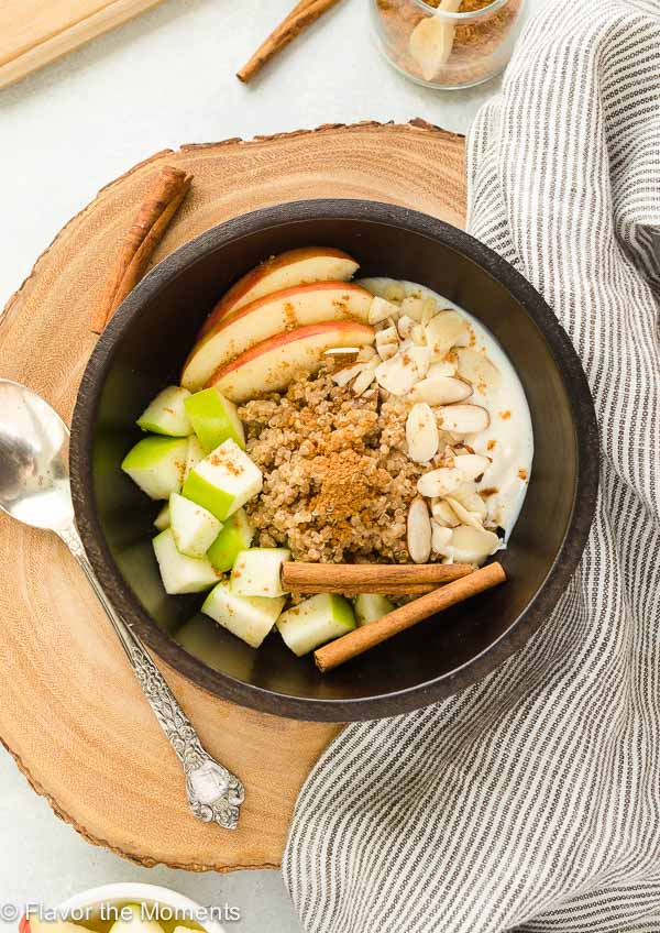 Vanilla Chai Breakfast Quinoa Bowls are a hearty, healthy breakfast packed with warm chai spice and cozy vanilla flavor. Top it with fresh fruit, almonds, and yogurt for one satisfying breakfast! @FlavortheMoment