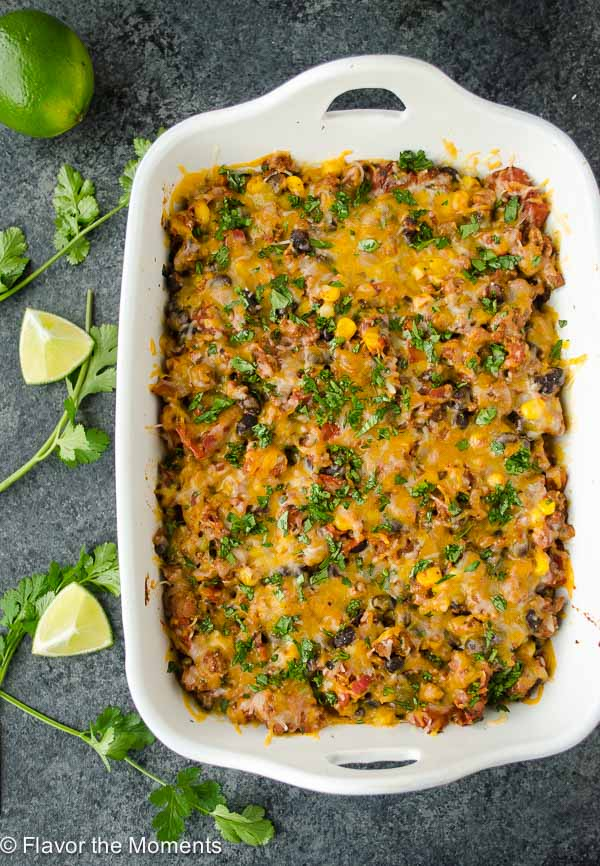Mexican Turkey Tortilla Casserole is delicious layers of seasoned ground turkey, whole wheat tortillas, and cheese. It's a quick, hearty meal that the whole family will love! @FlavortheMoment