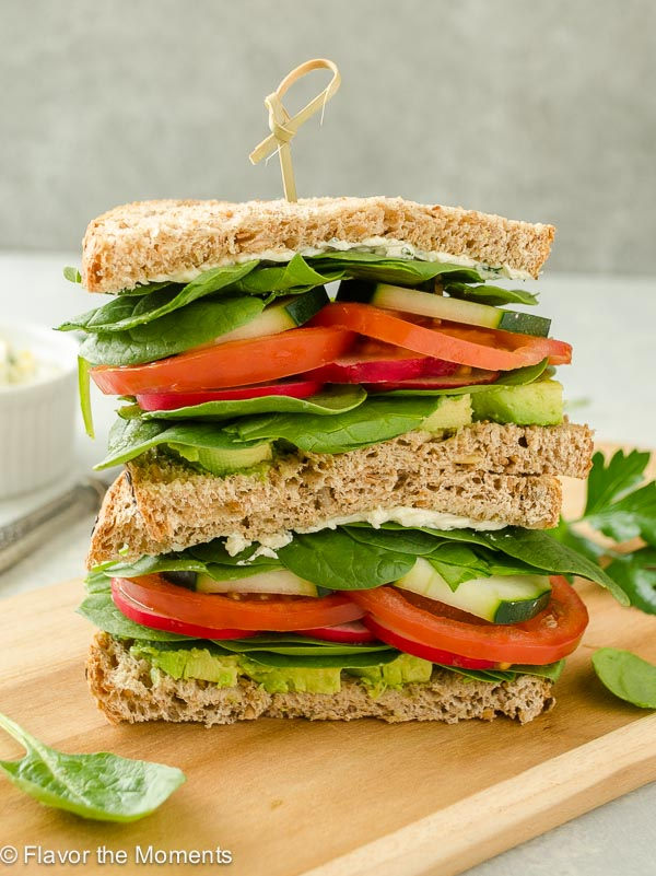 Ultimate Veggie Sandwich with Lemon Herb Cream Cheese is whole grain bread with a flavorful cream cheese spread piled high with fresh veggies. It's a delicious lunch that you can feel good about! @FlavortheMoment