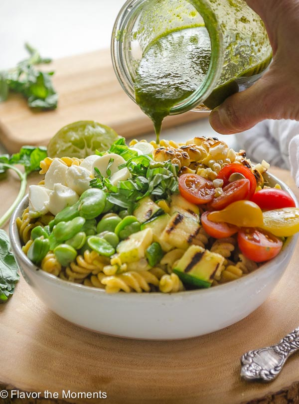 Grilled Vegetable Summer Succotash Pasta Salad is packed with grilled and fresh summer produce, fresh mozzarella pearls, and Chickapea gluten free pasta. It's tossed in a basil lime vinaigrette and is the ultimate summer pasta salad! @FlavortheMoment