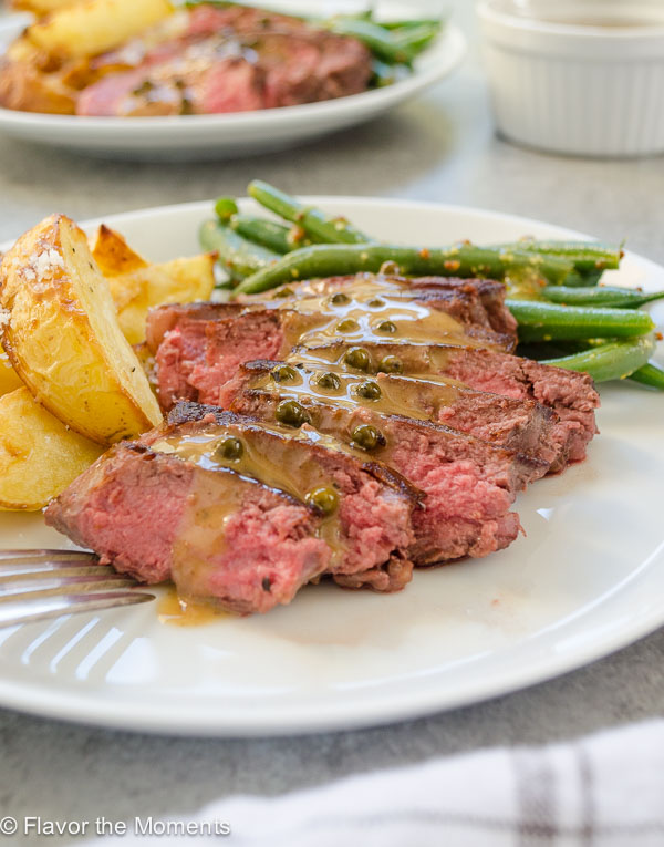 Seared Steaks and Green Peppercorn Sauce with Roasted Potatoes and Green Beans is easy, elegant meal that's guaranteed to impress! @FlavortheMoment