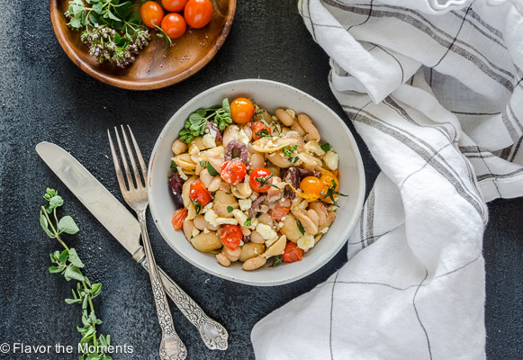 Greek Pasta Skillet with Burst Cherry Tomatoes is a high protein gluten-free pasta meal that's on the table in 25 minutes! @FlavortheMoment