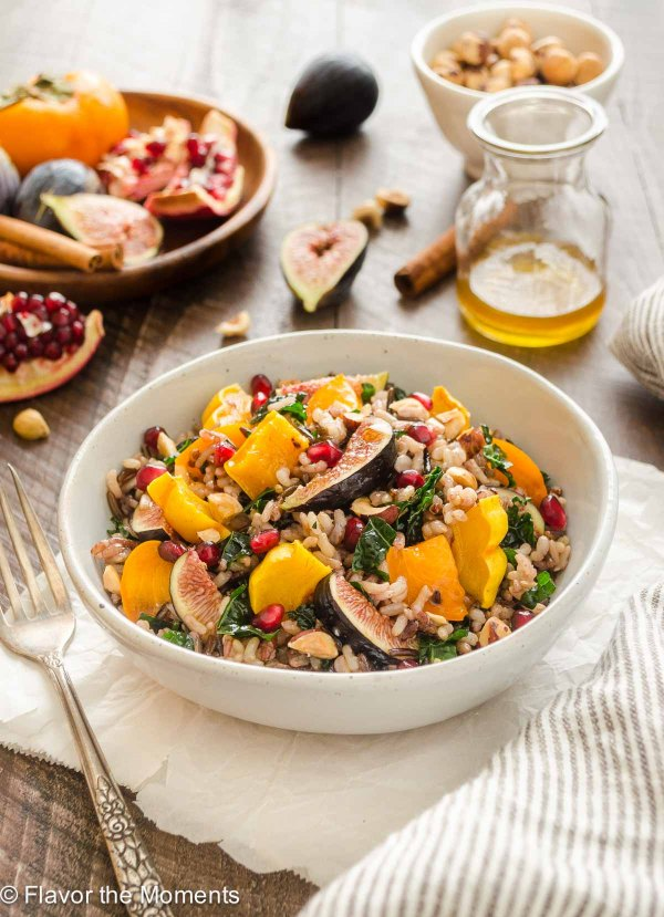 Roasted Delicata Squash, Fig, and Persimmon Wild Rice Salad is packed with kale, pomegranate, and tossed in a spiced maple vinaigrette! {V, GF}