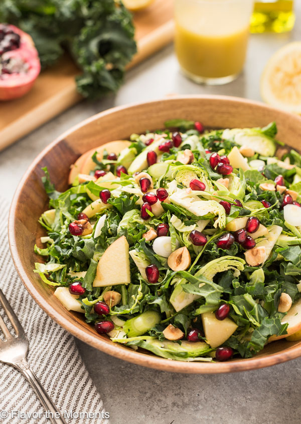 Kale and Brussels Sprout Salad with Lemon Vinaigrette is a crunchy vegan superfood salad with apple, pomegranate and toasted hazelnuts tossed in a refreshing lemon vinaigrette! {V, GF}