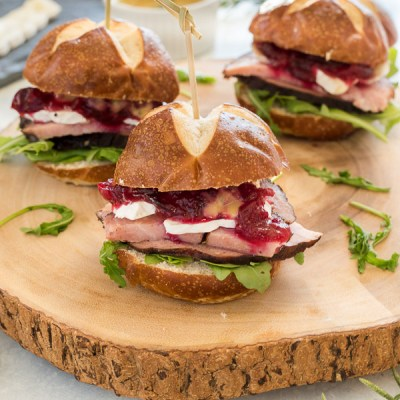 Ham, Brie and Cranberry Sliders with Maple Rosemary Mustard are festive, flavorful sliders that are perfect for holiday entertaining!