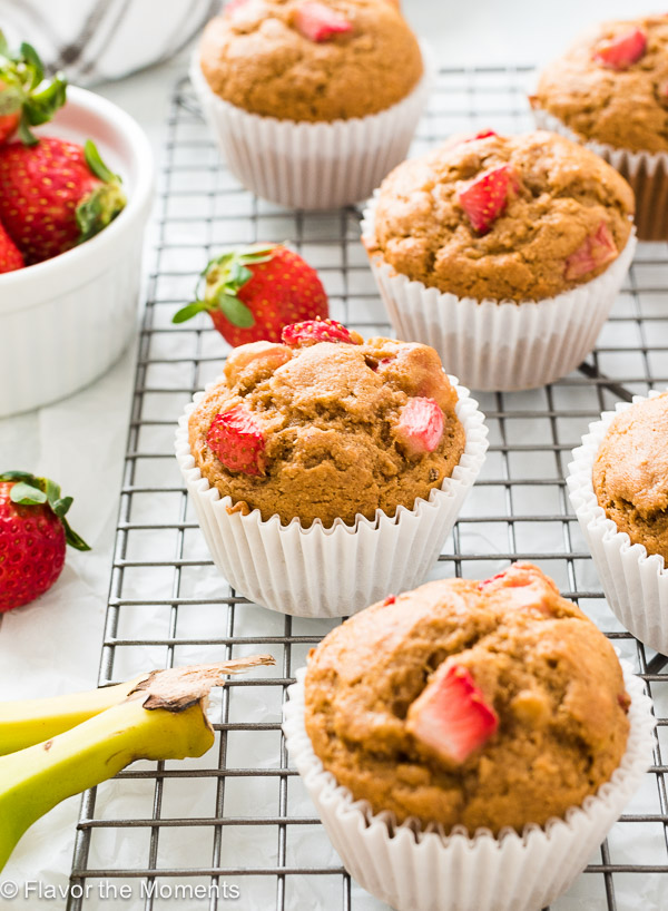 Healthier Strawberry Banana Muffins are light and fluffy whole grain muffins packed with fresh strawberry and banana flavor!