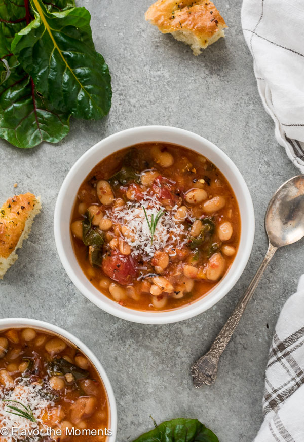 Instant Pot Spicy White Bean and Chard Stew is a mediterranean inspired stew with hearty white beans, swiss chard and red pepper flakes.  Top with parmesan for the perfect cozy meal! {GF, VEG}