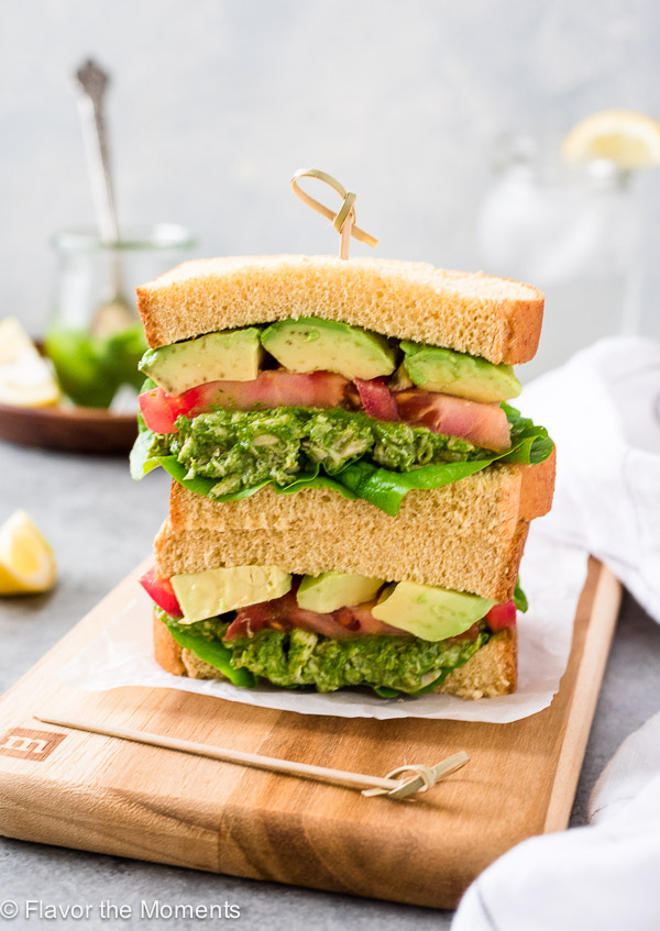 Pesto Chicken Salad Sandwiches are slices of fluffy, whole wheat potato bread filled with a creamy no mayo pesto chicken salad and plenty of veggies!