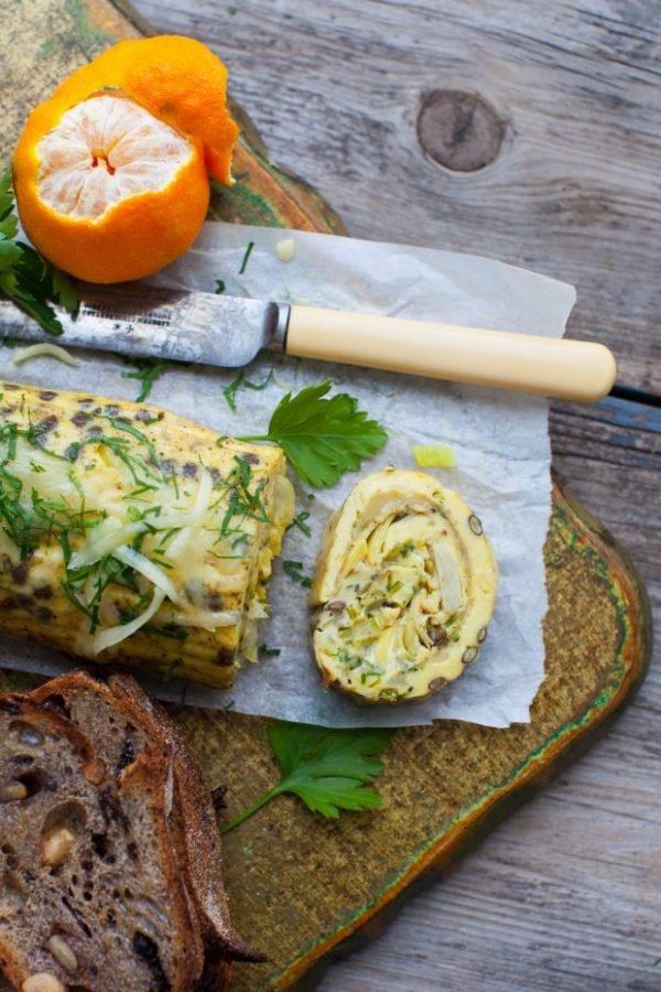 cheesy leek and lentil rolled omelet with artichokes