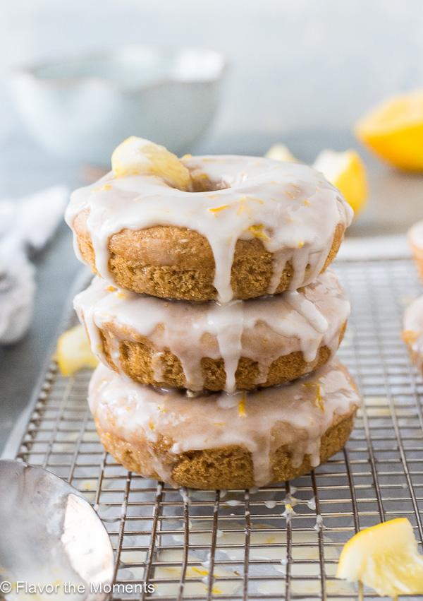 Lemon Glazed Baked Donuts are fluffy whole grain lemon cake donuts topped with a luscious lemon glaze!