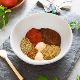 taco seasoning unblended in bowl angled view