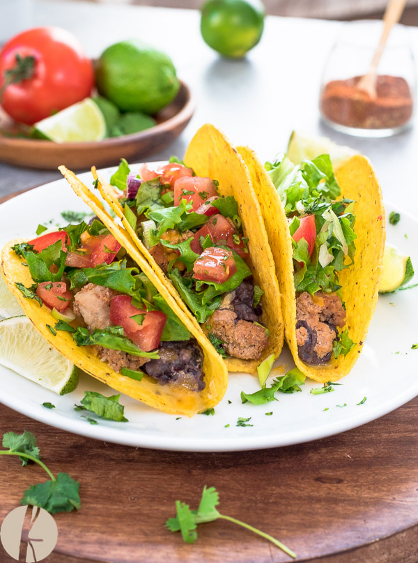 Oven Baked Turkey Black Bean Tacos are crisp taco shells filled with spicy ground turkey, homemade black beans and cheese.  Top with your favorite toppings for an easy weeknight meal!