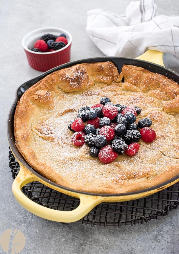 Mixed Berry Dutch Baby Pancake is an easy light, puffy pancake topped with mixed berries, whipped cream and powdered sugar!