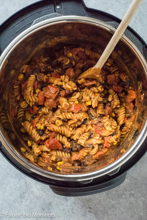 Instant Pot Pumpkin Black Bean Chili Mac is a protein-packed gluten-free Instant Pot pasta that's on the table in under 30 minutes!