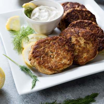 Crispy Salmon Cakes with Lemon Dill Sauce are low carb, grain free salmon cakes served with a creamy, no mayo lemon dill sauce! {Paleo, GF}