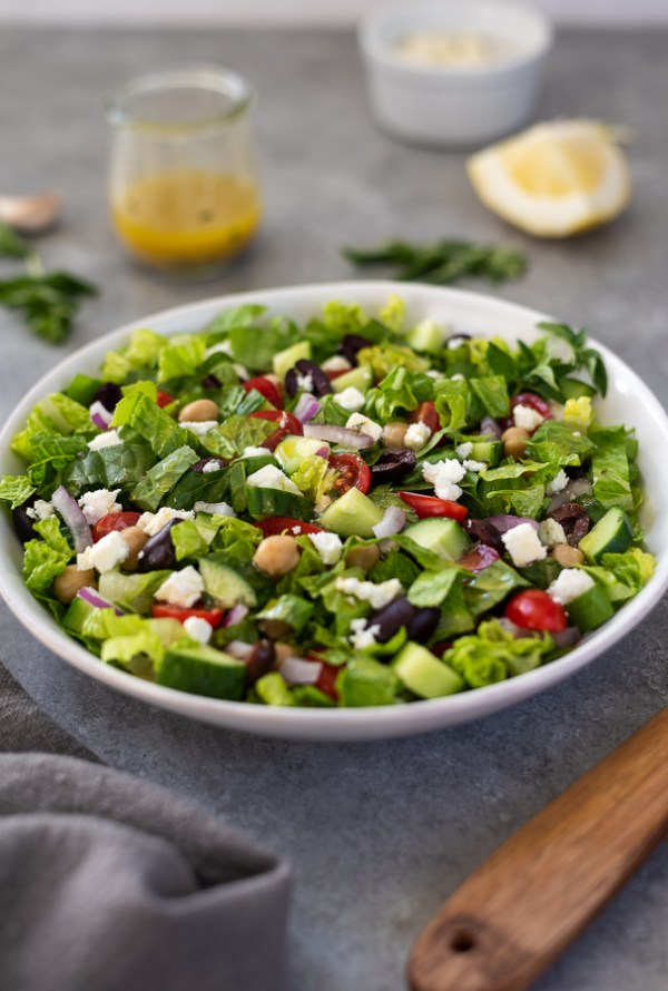 front view of Greek chopped salad in white bowl