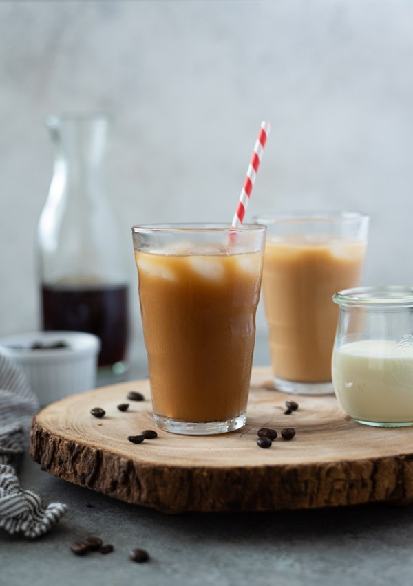 front view of cold brew coffee recipe in glass with ice and straw
