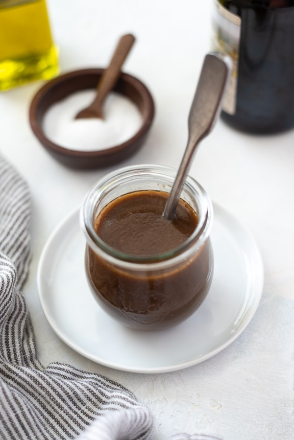 balsamic vinaigrette dressing in a jar with a spoon