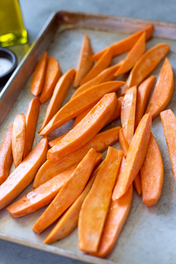 sweet potato wedges tossed in olive oil before grilling