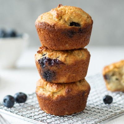 stack of almond flour blueberry muffins on a wire rack