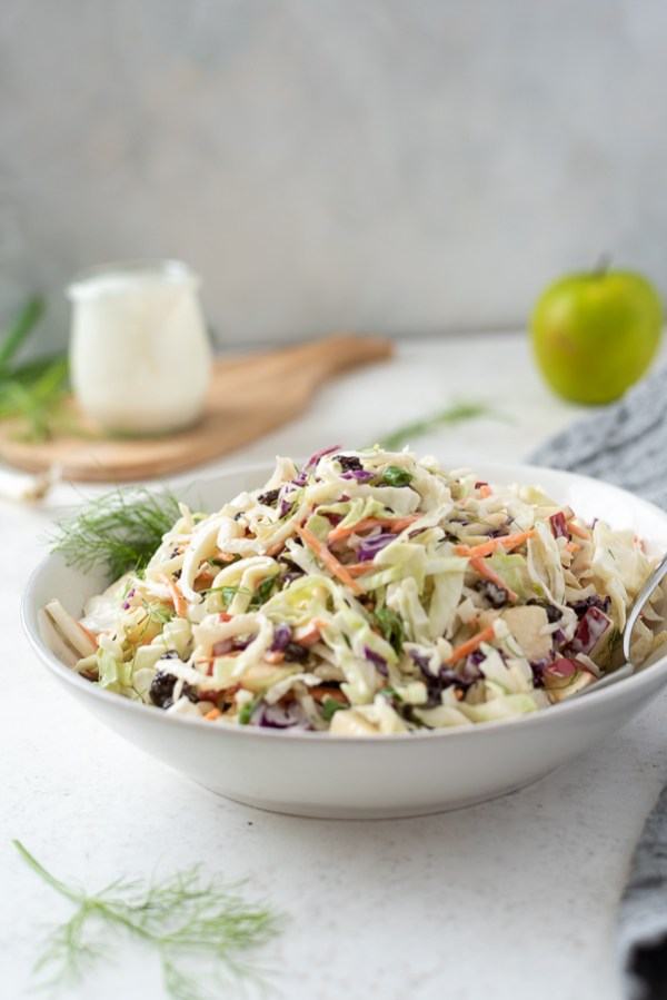 front shot of bowl of creamy no mayo coleslaw