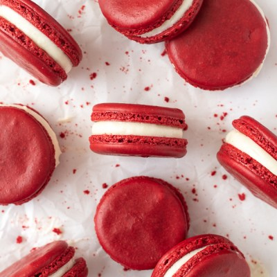 overhead shot of red velvet macarons with cookie crumbs