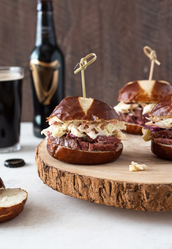 close up of guinness corned beef sliders with wooden pick