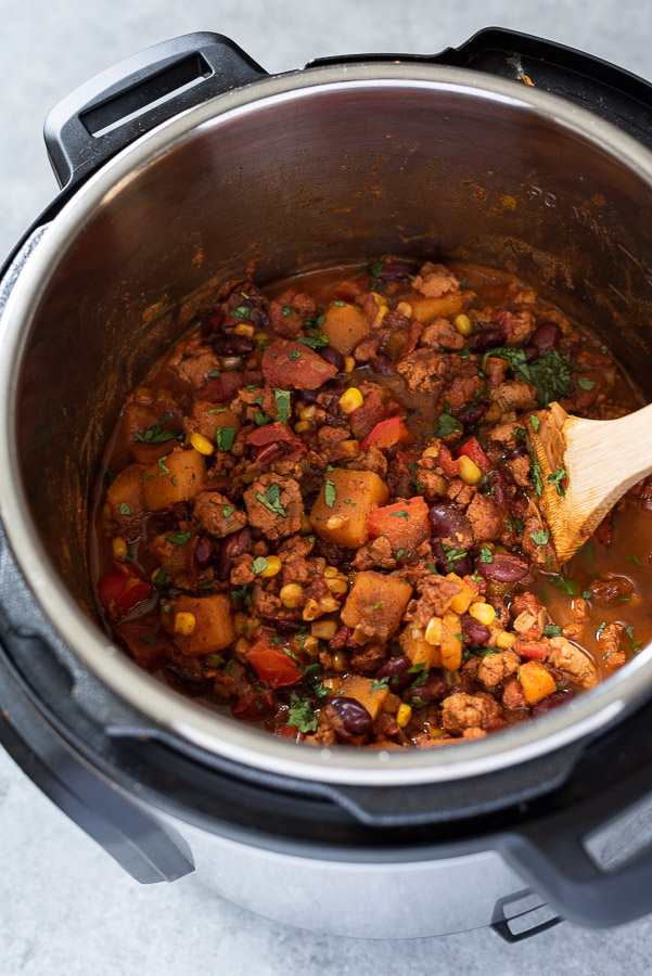 instant pot butternut squash chili with wooden spoon in center