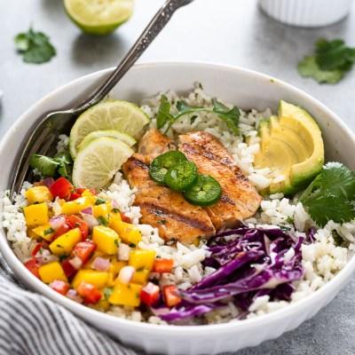 fish taco bowl wit fork buried inside and sliced jalapeño on top