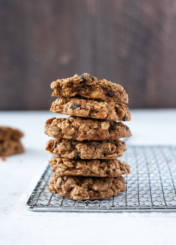 tall stack of carrot oatmeal cookies on a wire rack