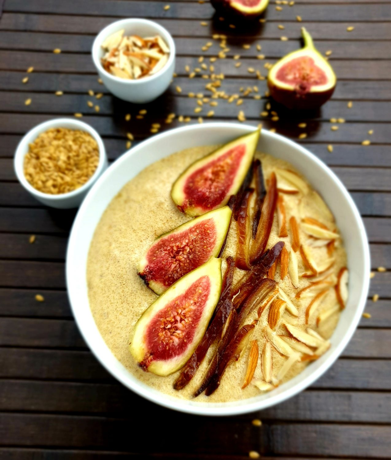 flaxseed porridge with figs and almonds in a white bowl