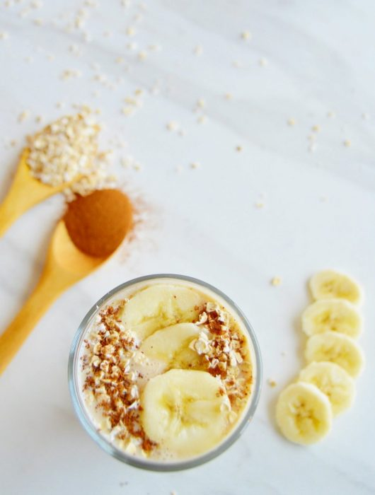 banana oatmeal smoothie in a glass.