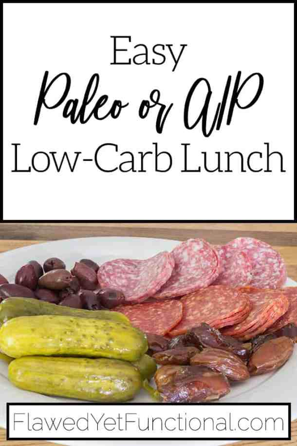 paleo low-carb lunch of salami olives pickles on white plate