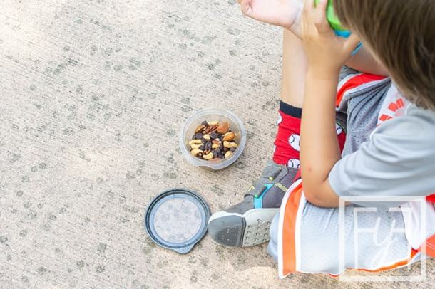 boy eating snack key to enjoying family vacations