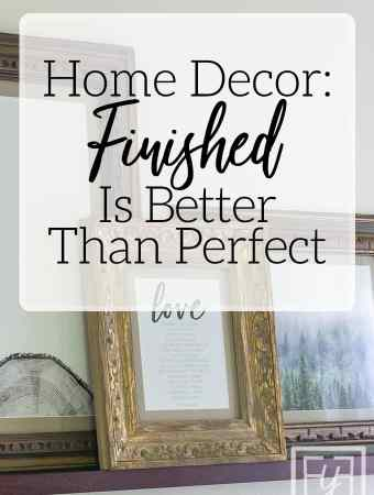 finished is better than perfect phrase over vintage frames hung on wall
