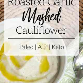 roasted garlic mashed cauliflower in white bowl